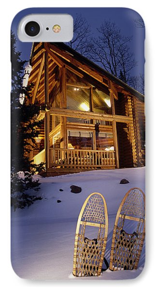 Lighted Cabin With Snowshoes In Front IPhone Case by Michael DeYoung
