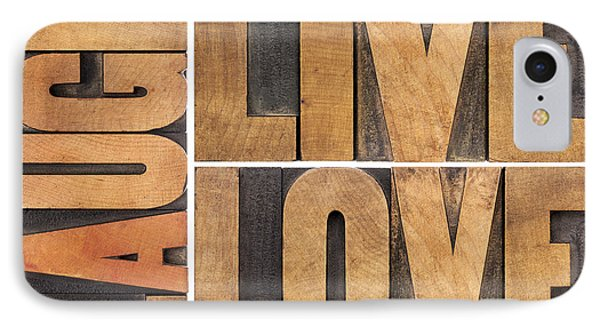 IPhone Case featuring the photograph Live Love And Laugh In Wood Type by Marek Uliasz