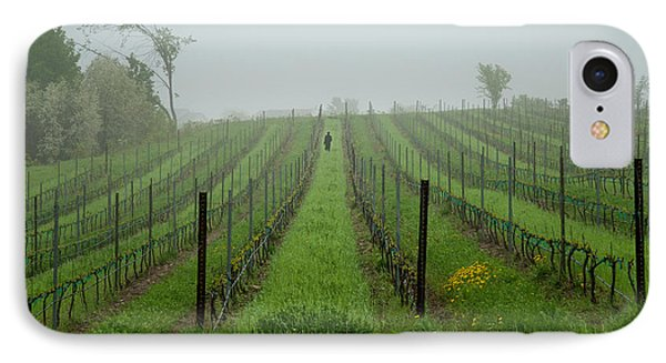 Lone Figure In Vineyard In The Rain On The Mission Peninsula Michigan IPhone Case by Mary Lee Dereske