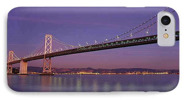 Low Angle View Of A Bridge At Dusk IPhone Case by Panoramic Images
