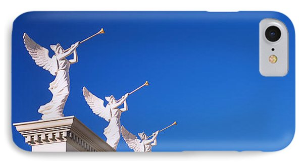 Low Angle View Of Statues On A Wall IPhone Case by Panoramic Images