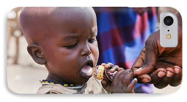 Maasai Child Trying To Eat A Lollipop In Tanzania Phone Case by Michal Bednarek
