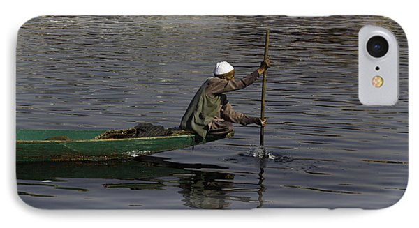 Man Plying A Wooden Boat On The Dal Lake IPhone Case by Ashish Agarwal