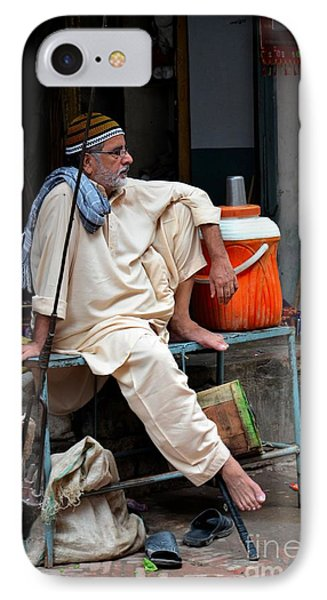 Man Sits And Relaxes In Lahore Walled City Pakistan IPhone Case by Imran Ahmed