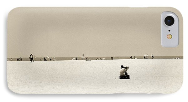 Man Sitting On A Beach Playing His Horn Phone Case by Stephen Spiller