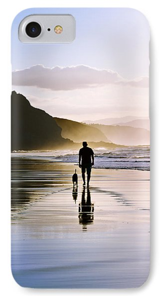 Man Walking The Dog On Beach IPhone Case by Mikel Martinez de Osaba