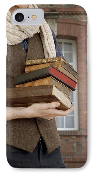 IPhone Case featuring the photograph Man With Books by Ethiriel  Photography