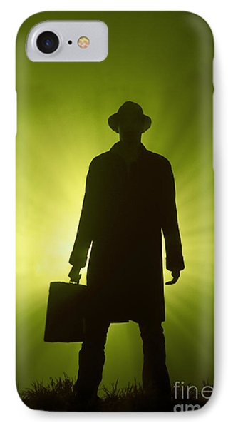 IPhone Case featuring the photograph Man With Case In Green Light by Lee Avison