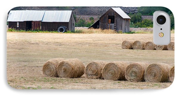 IPhone Case featuring the photograph Montana Bales by Vinnie Oakes