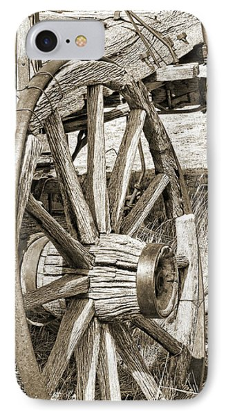 Montana Old Wagon Wheels In Sepia Phone Case by Jennie Marie Schell