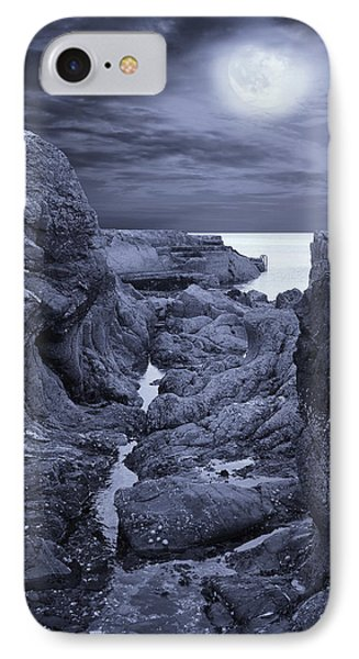 IPhone Case featuring the photograph Moonlight Over Rugged Seaside Rocks by Jane McIlroy