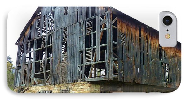 IPhone Case featuring the photograph More Holes Less Barn by Jeanette Oberholtzer