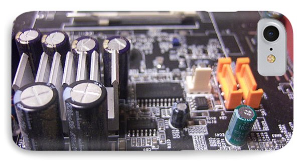 IPhone Case featuring the photograph Motherboard Tanks by Conor Murphy
