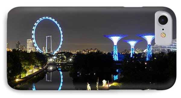 Night Shot Of Singapore Flyer Gardens By The Bay And Water Reflections IPhone Case by Imran Ahmed
