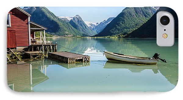 Reflection Of A Boat And A Boathouse In A Fjord In Norway IPhone Case by IPics Photography