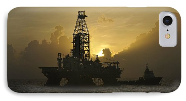 IPhone Case featuring the photograph Offshore Oil Rig With Sun And Clouds by Bradford Martin