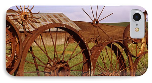 Old Barn With A Fence Made Of Wheels IPhone Case by Panoramic Images