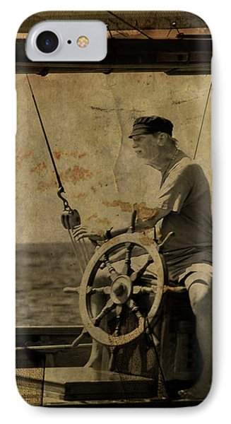 old sailor A vintage processed photo of a sailor sitted behind the rudder in Mediterranean sailing IPhone Case