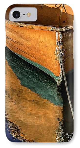 IPhone Case featuring the photograph Orange Dinghy In Warm Sun by Betty Denise