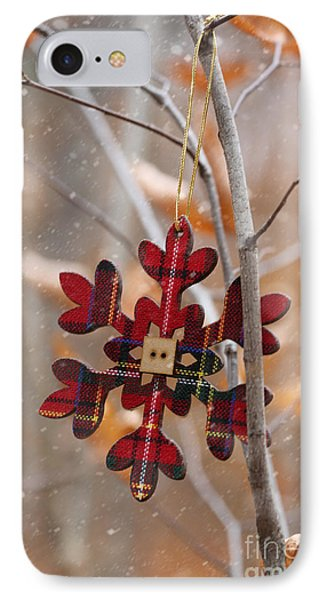 IPhone Case featuring the photograph Ornament Hanging On Branch With Snow Falling by Sandra Cunningham