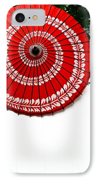 Paper Umbrella With Swirl Pattern On Fence Phone Case by Amy Cicconi