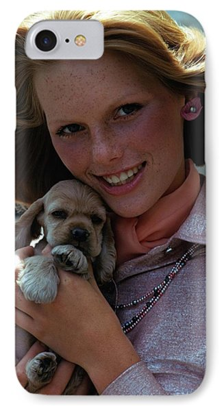 Patti Hansen Carrying A Puppy IPhone Case by William Connors