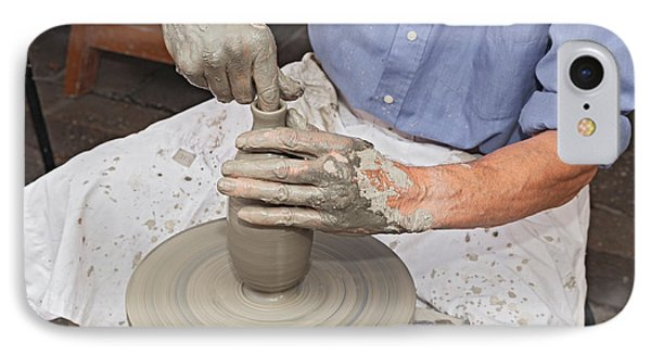 Potter Shaping Clay On A Potter's Wheel  IPhone Case by Ermess Images