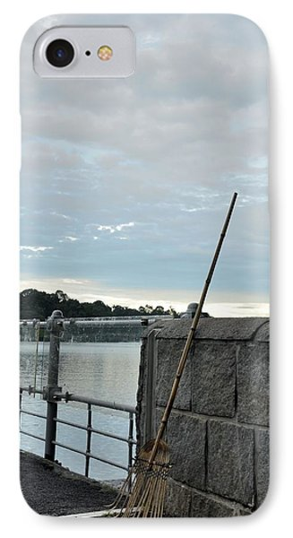 IPhone Case featuring the photograph Rake Rests Itself After A Hard Days Work by Imran Ahmed