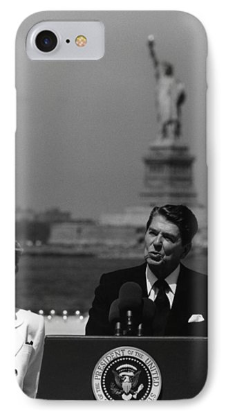 Reagan Speaking Before The Statue Of Liberty IPhone Case by War Is Hell Store