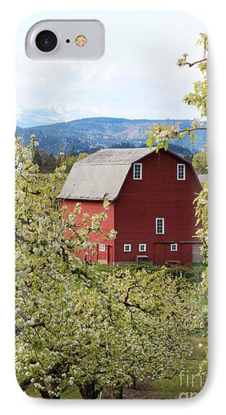 IPhone Case featuring the photograph Red Barn And Apple Blossoms by Patricia Babbitt