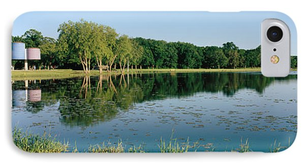 Reflection Of Trees In Water, Warner IPhone Case by Panoramic Images
