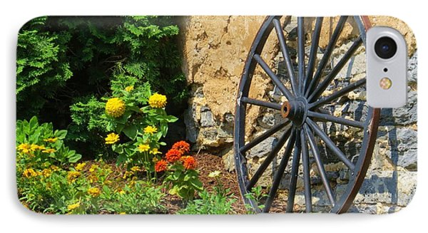 IPhone Case featuring the photograph Retired Wagon Wheel by Jeanette Oberholtzer
