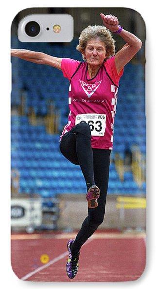 Senior British Female Athlete Mid-air IPhone Case by Alex Rotas