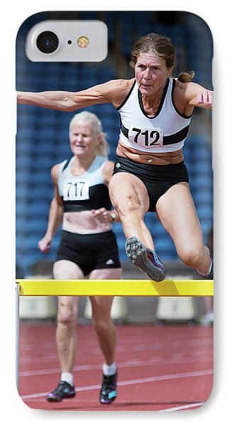 Senior Female Athlete Clears Hurdle IPhone Case by Alex Rotas