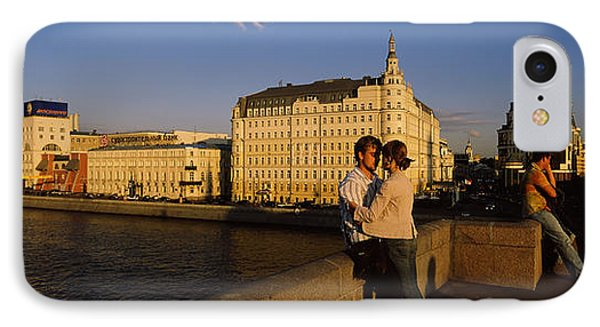 Side Profile Of A Couple Romancing IPhone Case by Panoramic Images
