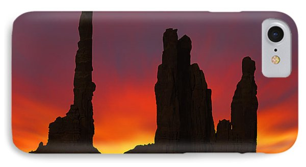 Desert Sunset iPhone 7 Case - Silhouette Of Totem Pole After Sunset - Monument Valley by Mike McGlothlen