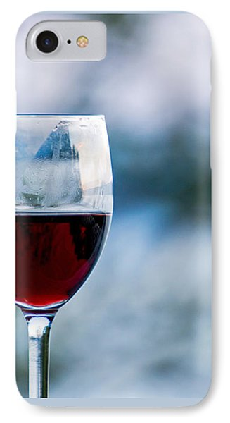 Single Glass Of Red Wine On Blue And White Background Phone Case by Photographic Arts And Design Studio