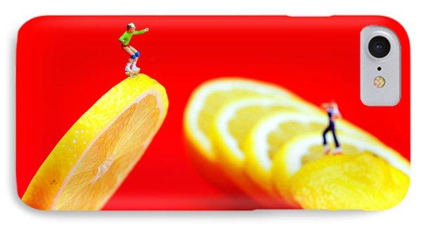 Skateboard Rolling On A Floating Lemon Slice IPhone Case by Paul Ge