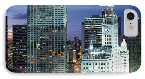 Skyscraper Lit Up At Night In A City IPhone Case by Panoramic Images