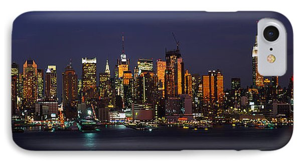Skyscrapers Lit Up At Night In A City IPhone Case by Panoramic Images