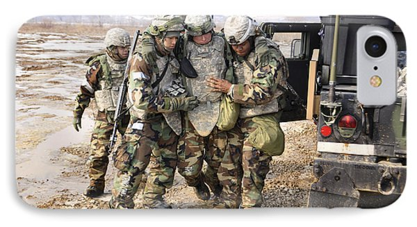 Soldiers Conduct Medical Evacuation Phone Case by Stocktrek Images
