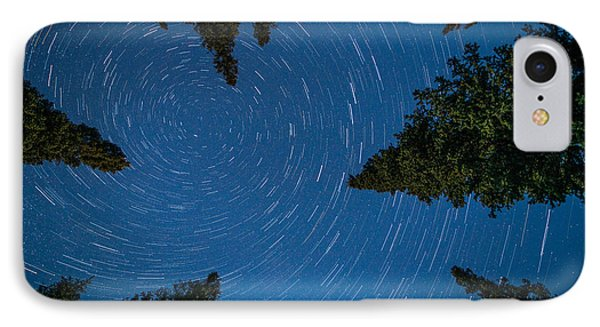 Swirling Stars Over The Spruces IPhone Case by Roger Clifford