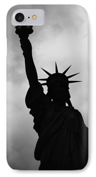 IPhone 7 Case featuring the photograph Statue Of Liberty Silhouette by Dave Beckerman