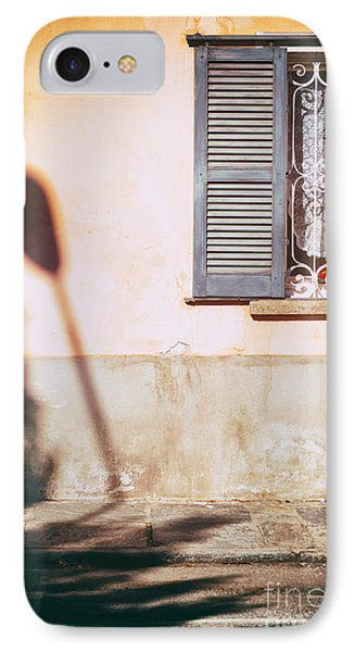 IPhone 7 Case featuring the photograph Street Lamp Shadow And Window by Silvia Ganora