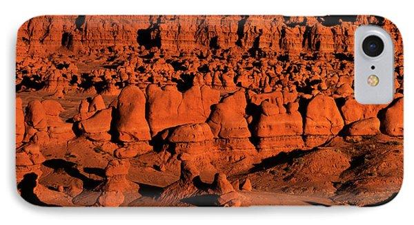 Sunset Light Turns The Hoodoos Blood Red In Goblin Valley State Park Utah IPhone Case by Dave Welling