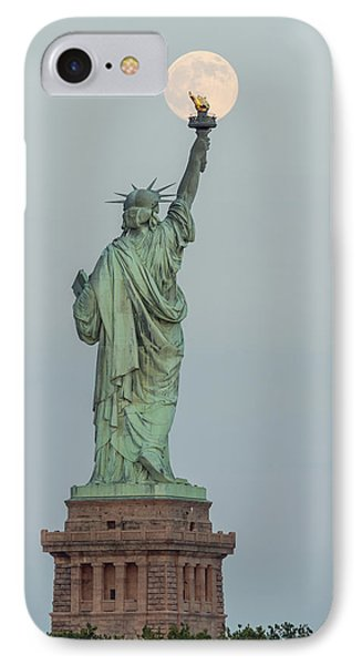 Super Moon Rises Over The Statue Of Liberty IPhone Case by Susan Candelario