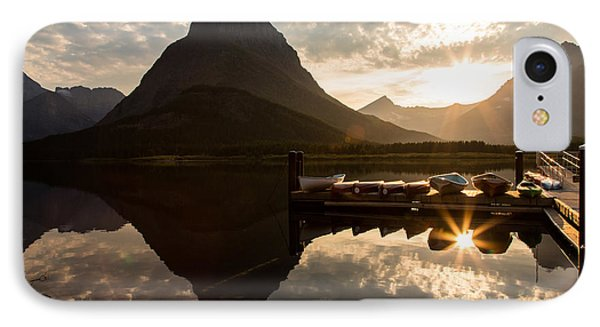 Swiftcurrent Lake Boats Reflection And Flare Phone Case by John Daly