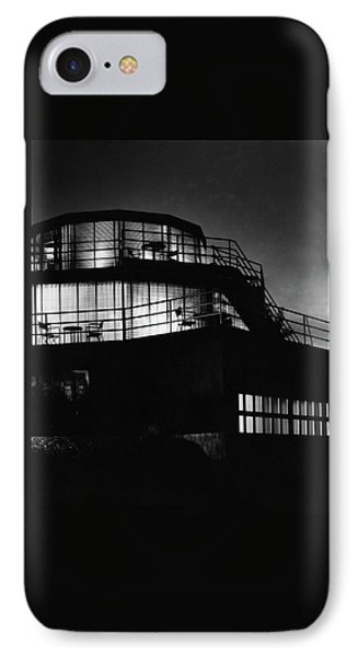 The Exterior Of A Spiral House Design At Night IPhone Case by Eugene Hutchinson
