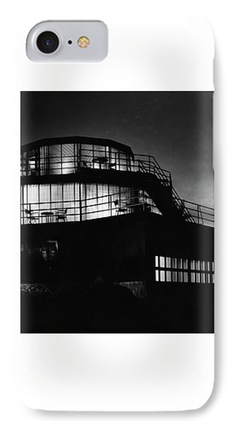 The Exterior Of A Spiral House Design At Night IPhone Case
