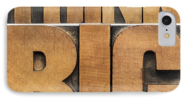 IPhone Case featuring the photograph Think Big In Wood Type by Marek Uliasz